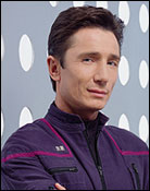 Headshot of Dominic Keating